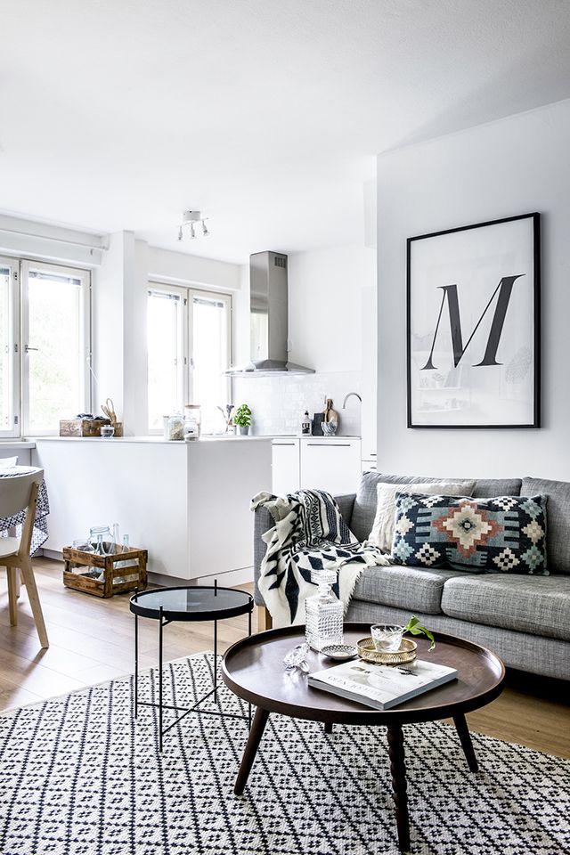 Amazing patterned rug, gray sof, and oversized letterpress art!
