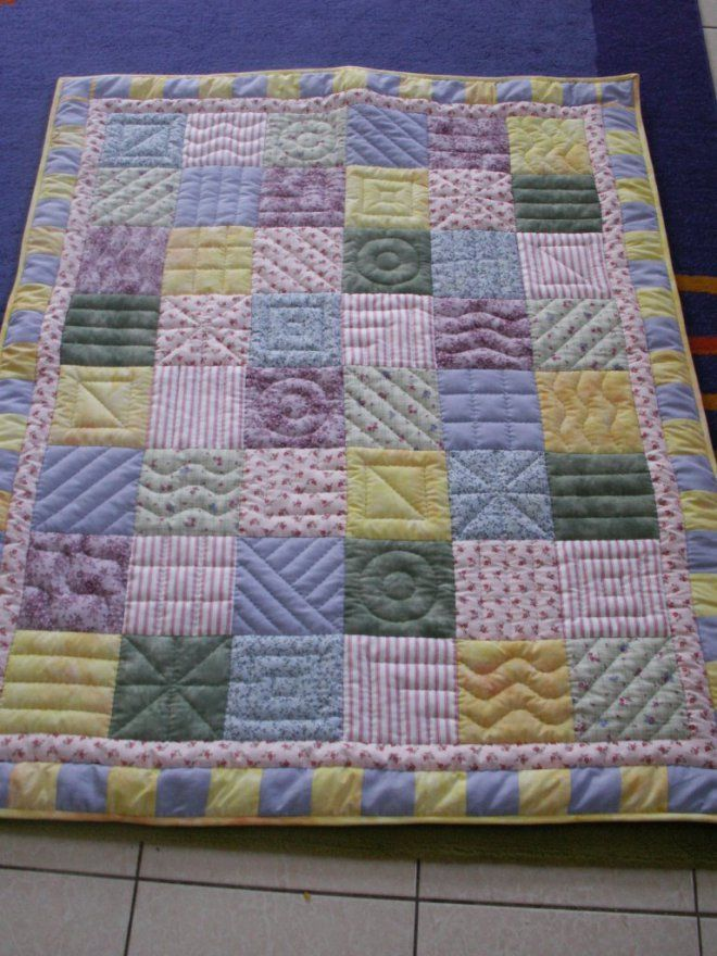 Pastel baby quilt | The Purple Giraffes  like the quilting in the squares.