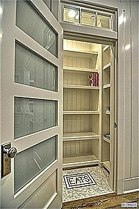 paneled glass pantry door & tile flooring