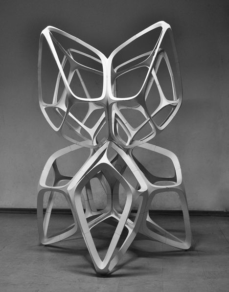 Students built this delicate stacked sculpture to demonstrate the structural properties of curve-folded paper.