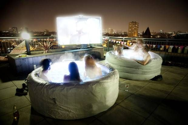 These people decided that hot tubs and a movie make a great evening. Too bad they didn't choose Bullfrog Spas, they might actually be comfortable as they watched their movie.