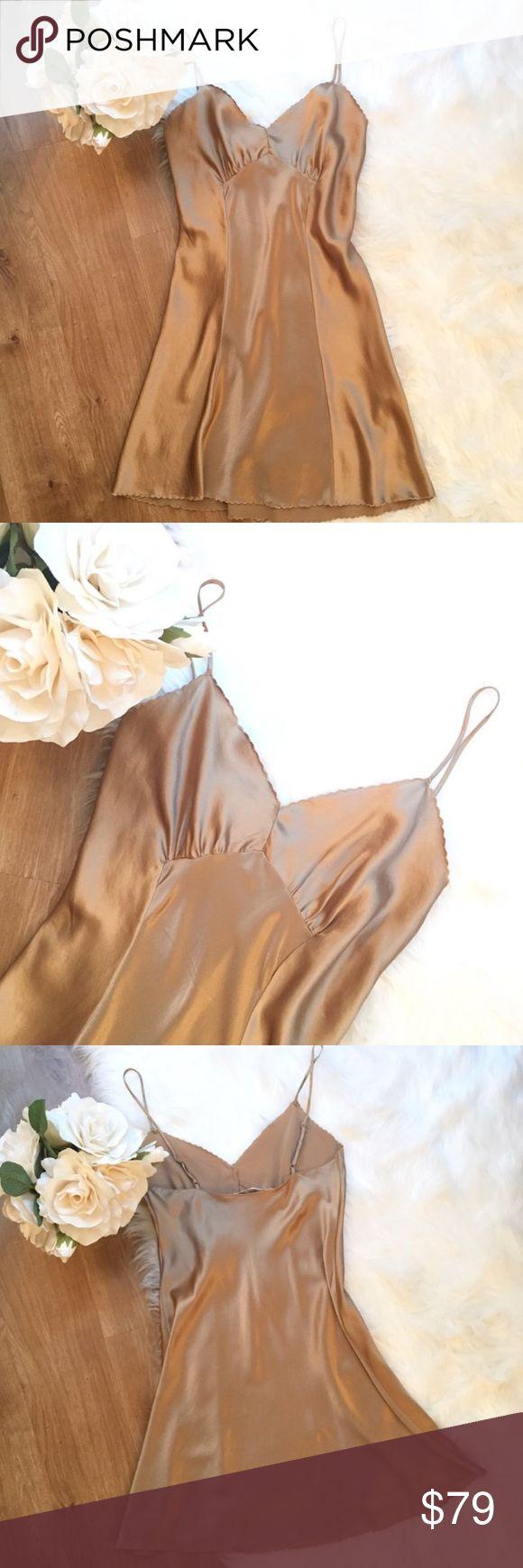 Victoria's Secret vintage silk gold slip dress Vintage early 2000's Victoria's Secret lingerie silk slip dress. 100% SILK gold/bronze silky slip dress. Scalloped petal trims. EXCELLENT/like new condition. Size SMALL Victoria's Secret Dresses Mini
