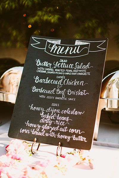 """Swap in: A larger sign or one per table""""Order fewer stationery items than your guest count on the details that don't need to be one per person. For example, menu cards can be swapped for a larger sign or one per table. Items such as bar menus or ?hashtag signs can be moved by your planner? from one area to the other, instead of doing? three or more of each,"""" say the pros at LVL Weddings"""