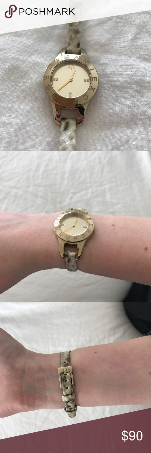 Armani Exchange Snakeskin & Gold Watch Authentic Armani Exchange Gold & Snake Skin watch. Received as a gift and don't wear very much. It is in perfect condition.. I think the battery would just need to be replaced. Let me know if you have any questions!! Thanks! A/X Armani Exchange Accessories Watches