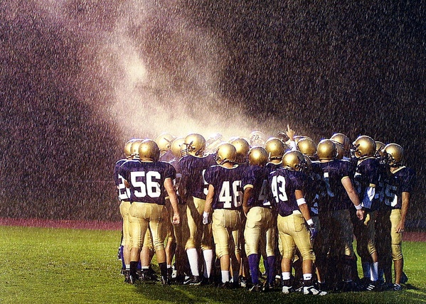 Huddle in the rain.