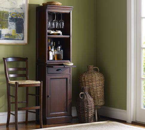 Simple, small, quaint bar with cabinet tower.  Perfect piece of furniture for a dining room!