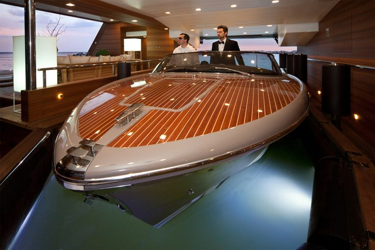 CRN mega yachts j'ade is world's first to feature a floating garage