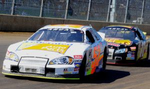 Ken Schrader (52) holds off Tom Hessert en route to winning ARCA Racing Series Southern Illinois 100 at the DuQuoin (Ill.) State Fairgrounds 9.2.13. (Ken Simon Photo)