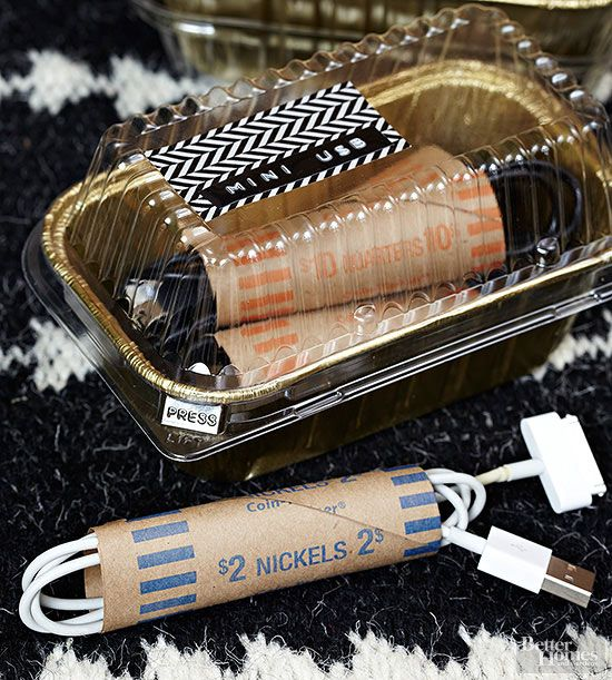 Inexpensive paper coin wrappers pull double duty to corral cords, which are neatly contained in foil loaf pans. The pans are then stacked in a box, keeping a wealth of cords organized, easy to find, and tangle-free./