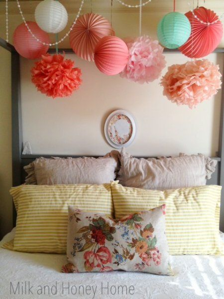 Girl's room ideas: funky hanging paper lanterns, tissue paper balls, and string of beads.
