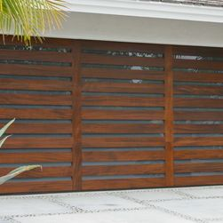 modern car door garage with slats of wood and glass