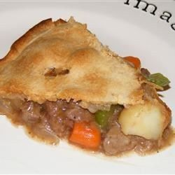 A great deep dish meat pie made with potatoes, carrots and peas in a rich gravy. Lamb chicken or pork can be used in place of beef. A great recipe for leftover meat!