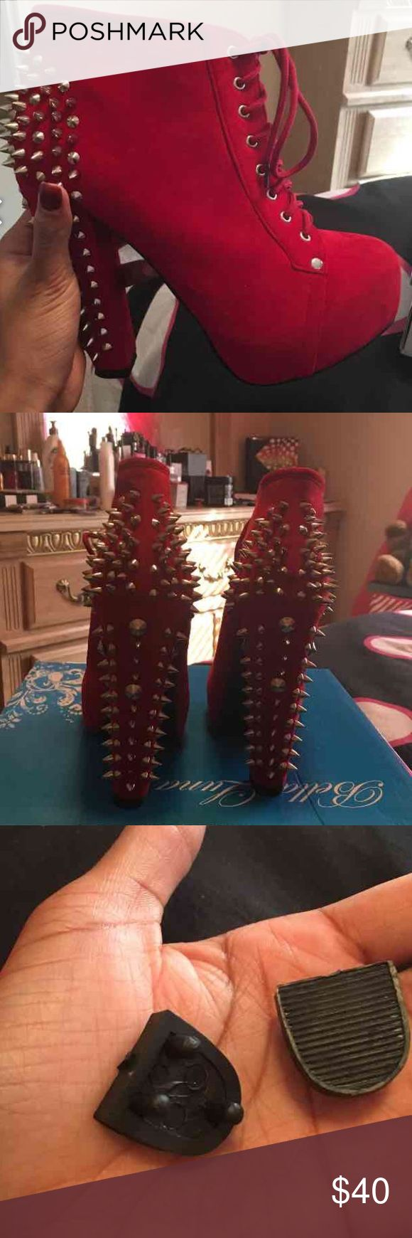 Red spiked heeled booties Red booties with spiked heels.  Size 6.  Never worn.  Comes with replacement heel bottoms.  Smoke free home.  Price is negotiable Shoes Ankle Boots & Booties