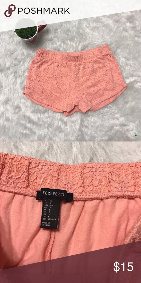 Forever 21 light pink shorts Forever 21 light pink shorts with a lace flower design throughout the shorts it's in great condition with no rips and no stains. Forever 21 Shorts
