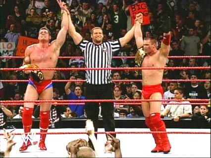 On This Day January 6 2003 On  WWE Monday Night Raw Lance Storm & William Regal win the Tag Team Tiles over Booker T & Goldust .