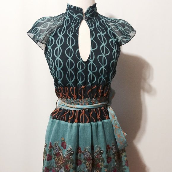 Desigual Silk Navy & Turquoise Print Dress Stunning dress! Silk print fully lined in cotton. Featuring stand ruffle collar, fluttered cap sleeve, one button keyhole neck closure, elastic waistband with self belt, ruffle hem details. 100% silk 100% cotton lining hand wash Desigual Dresses
