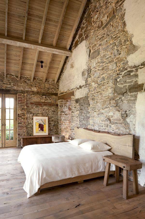 Exposed brick in the bedroom ... #coachbarn #bedroomdesign