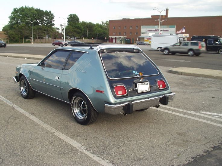"""1978 AMC Gremlin.  What color is this? Not on the AMC charts. Possibly repainted a non original color. I recognize the Tri-County flea market in Levittown. I wonder if this is the Gremlin I used to see in Long Beach. Update: this green is the rare """"silver Green"""" used on Nissans in 1989-1990. It has since been repainted red."""