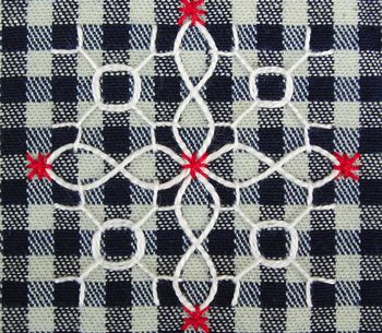 bordado sobre tecido de xadrez