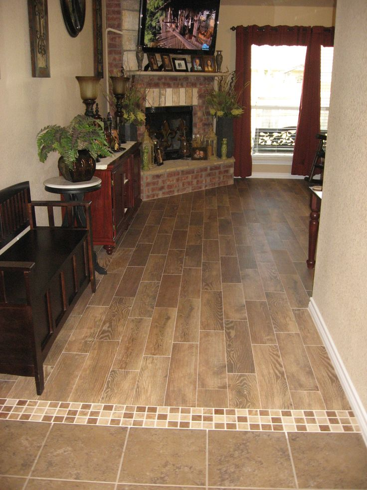 Transition with wood plank tile transition ideas for Flooring transition from kitchen to family room