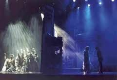 SPECIAL EFFECTS  In this live scene we can see that the group of people on the left hand side of the stage is being lit by rays of white light, to increase the focus on them and to show definition and movement within so many characters. While on the other side we have a sombre blue, and we can only see two shadows. Perhaps a sad scene or death.