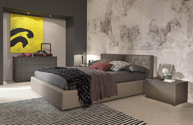 High quality transitional design bedgroup in Italian leather. Clean, contemporary lines and just enough decorative details combine to create the transitional modern platform bed. The headboard features an eclectic mix of square leathers and leather frame. A rectangular frame upholstered in Italian b...