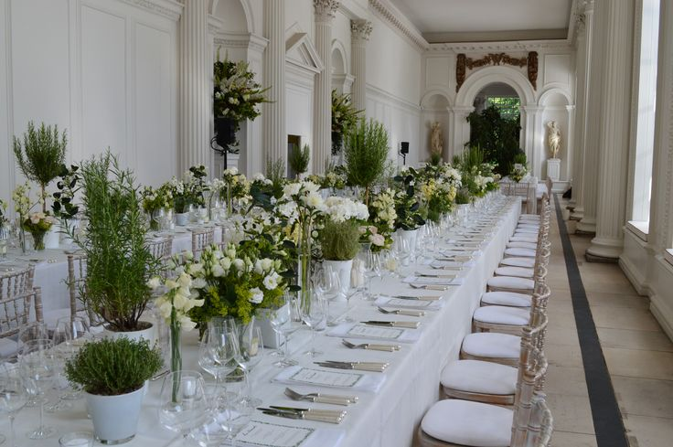 Banqueting tables and green succulents, for a unique wedding reception in the Orangery, at Kensington Palace