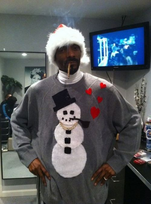 """Nothing says """"Merry Christmas"""" like Snoop Dogg smoking a blunt in a snowman sweater."""