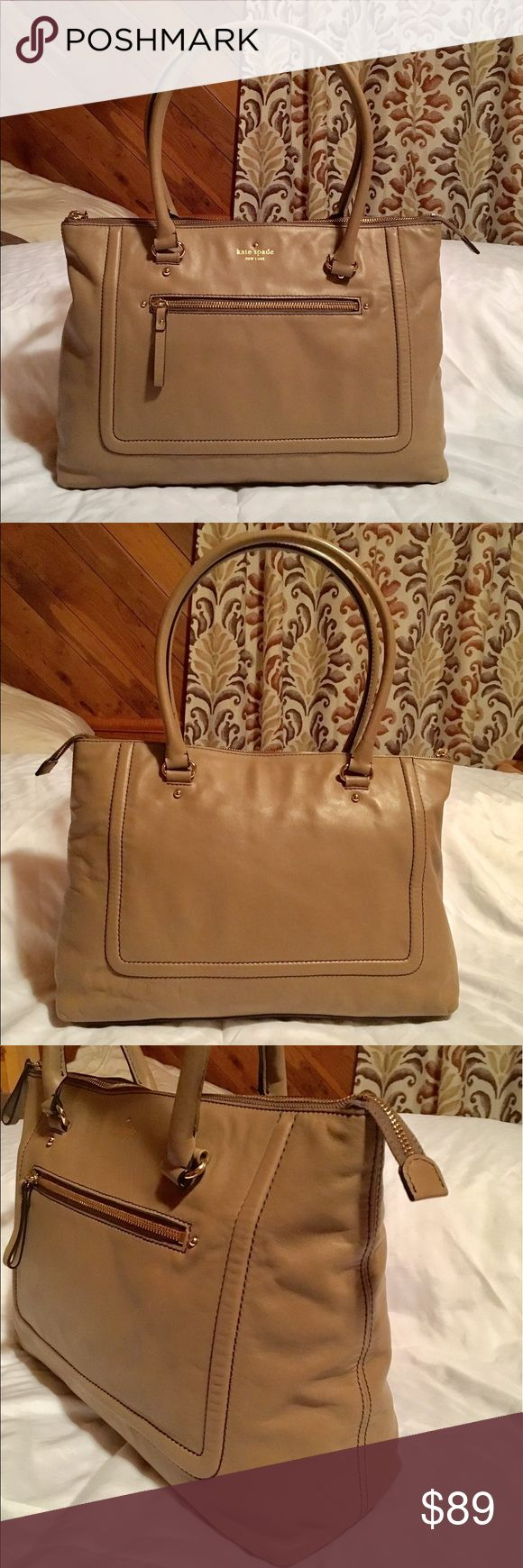 ♠️Kate Spade♠️Mott Street Judd Medium Tote ♠️Kate Spade♠️Mott Street Judd Medium Tote  In good condition.Smooth leather with zip pocket and embossed designer logo at front.Clean exterior and interior.With defect glue inside lining close to zipper as seen in the pictures.Four feet at base.Doulble shoulder straps good condition,front zip pocket,and top zip closure.This size correspondence is recommended items to school or work.Came from a smoke free and pet free home.I'm open to negotiate…
