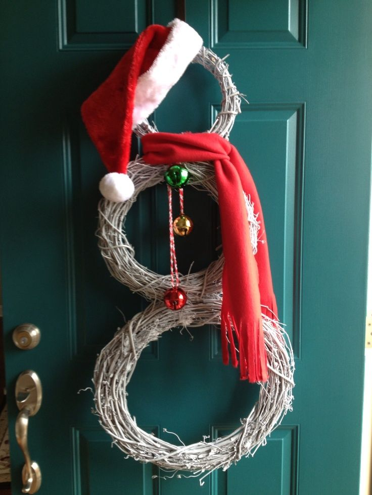 My snowman door wreath made from 3 grapevine wreaths. | Christmas