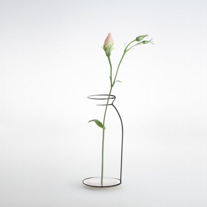 delicate sculptures byMaya Selway, each of which are handmade out of oxidized copper and fine silver. By recreating the most minimal outlines of these familiar objects