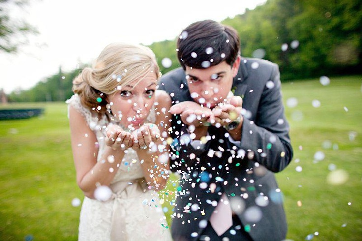 Blowing confetti/glitter into the camera, aw that's cute. Wedding pictures don't have to be all grown up you know. That's just boring.
