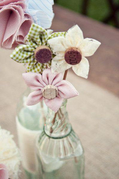 ohyaydesign:    DIY fabric flowers    I really like these fabric flowers in the bottle! I'm on a bit of a mission to sort out my centerpieces, so sorry if I spam non-floral centerpieces a lot in the next coming while.