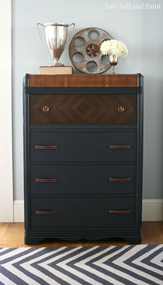 Charcoal gray waterfall dresser. Made me wonder about dark blue grey and dark wood