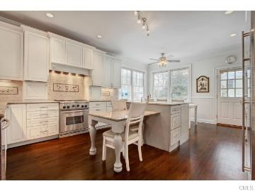 Love how this came out!  Repainted white.  Would never know it was originally Oak.  $3,000 to repaint professionally. Featured Properties : Fairfield County CT Real Estate : Denise Walsh & Partners