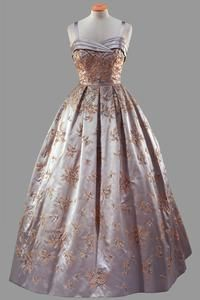 Queen Elizabeth's dress  Grey satin dress with full skirt embroidered with gold bugle and grey beads and crystals  Hardy Amies  Worn during the State Visit to America, for a State Banquet at the White House given by President Eisenhower, October 1957.