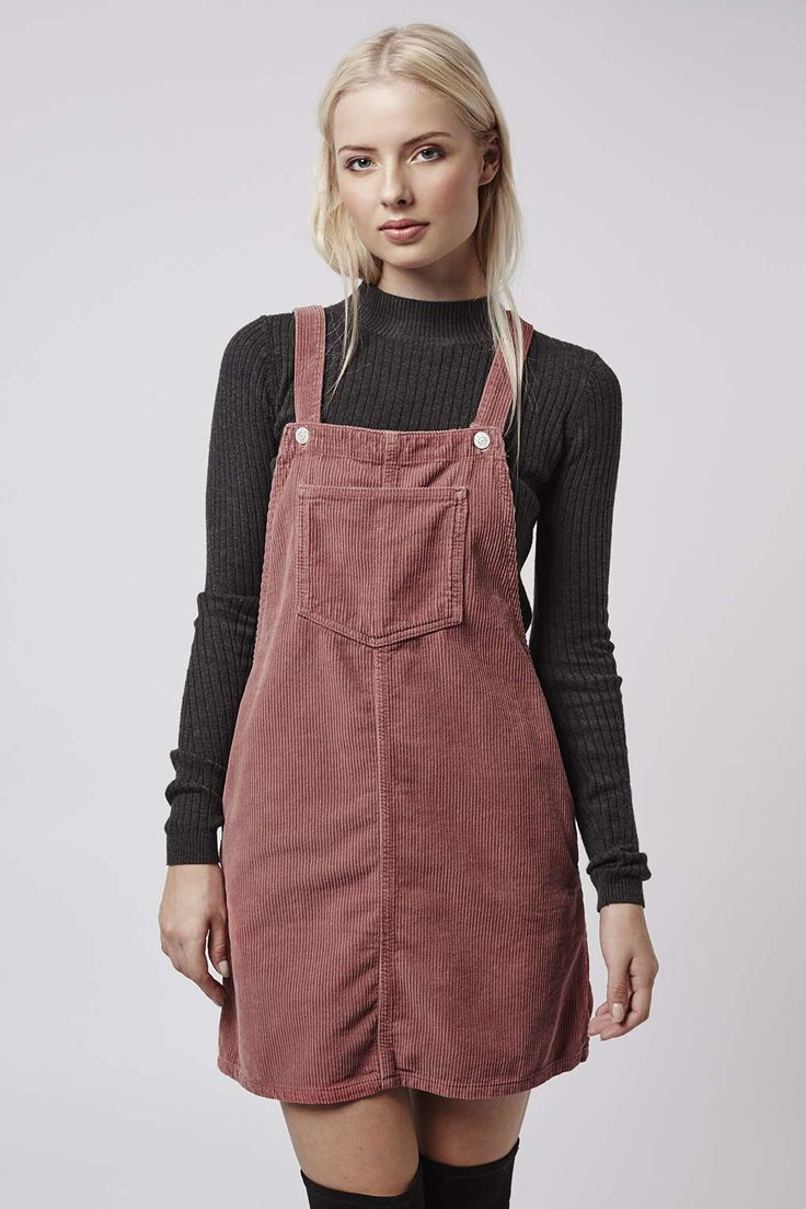 Change up your denim game by opting for a cord alternative. This dusky pink pinafore dress will see you through to next season effortlessly. #Topshop