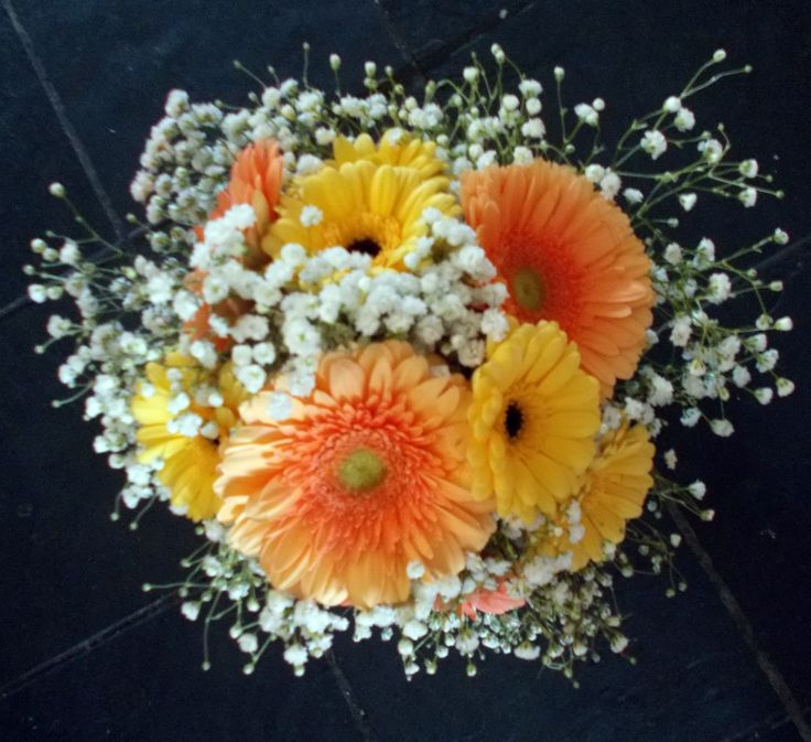Gerberas and gypsophila in tones of coral and yellow