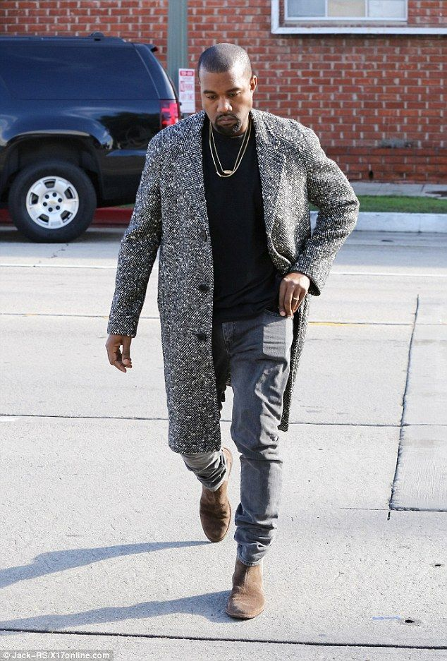 Why so serious: Kanye West appeared to be in a somber mood as he made his way into a studio in Hollywood on Wednesday