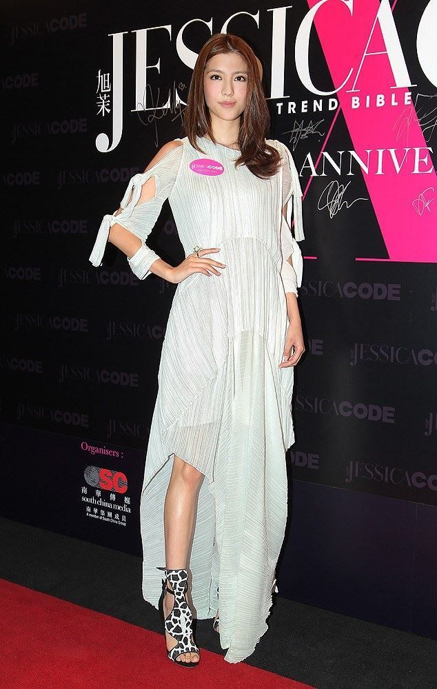 Hong Kong actress Karena Ng poses as she arrives at the fashion party of Jessica magazine in Hong Kong, China, May 29, 2014
