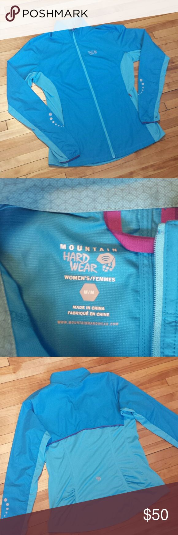 Mountain Hard Wear running jacket Purchased at local outfitter for $80 and only worn once. There is a stain on left cuff but not very noticeable when wearing and priced accordingly. Selling because I have many jackets! Hope someone can enjoy! Can be used for running, hiking, cross country skiing, etc. Mountain Hard Wear Jackets & Coats Utility Jackets