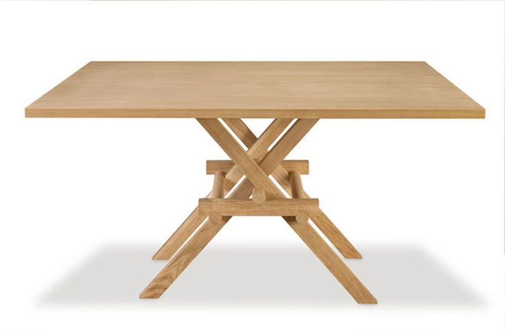 LEONARDO, table made of solid oak. The joints of the legs, without metal joints, is inspired by the construction of movable bridges of Leonardo da Vici. Design Marco Ferreri
