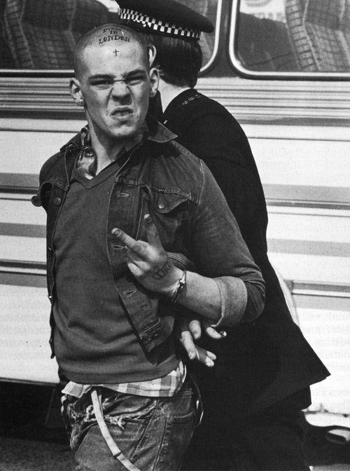Nick Knight - Skinhead. 1982 | 1980's | arrest | police | the bird | the finger | rude boy | tattoo | conformist | rebel | rebellion | reckless | delinquent |