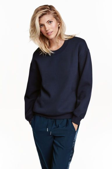 Sweatshirt: Top in soft sweatshirt fabric with dropped shoulders, long sleeves and ribbing around the neckline, cuffs and hem. Soft brushed inside.