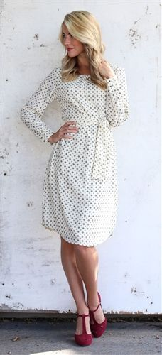 This modest little number is trendy is super cute! Flattering fit dress features round neckline with small pleats, long sleeves with two button details on the cuffs and matching tie sash. Fully lined.