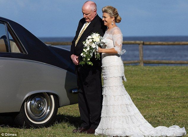 Father figure: Actor Ray Meagher, who plays Marilyn's good friend Alf Stewart in the show, walked her down the aisle
