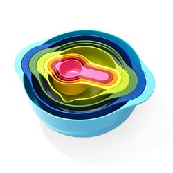Nest 8 Multicolour Space-Saving Kitchenware  Together at Last  From measuring cups to mixing bowls, with a colander and a sieve in between, this color-coated set keeps eight kitchen essentials in one bright spot.