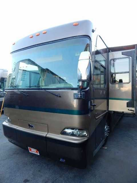 2004 Used Monaco Safari Panther Class A in California CA.Recreational Vehicle, rv, 2004 Monaco Safari Panther triple slide-out. This was Safari's top of the line model in 2004. Features include a HUGE Caterpillar C-12 engine with 505 HP and 1550 ft lbs of torque, an Allison six-speed 4000 series transmission, eight brand new tires, new fuel filters, new oil and oil filters, new LED TVs, an Onan 7.5 kW diesel generator, a full aqua hot heating system and hot water, the renowned Roadmaster ten…