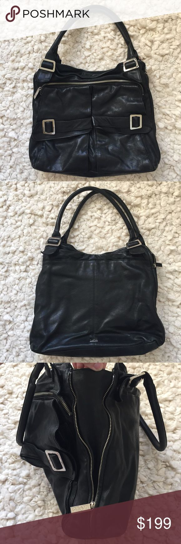 Kooba Large Black Leather Tote Great tote purchased at Bloomingdales. Great condition but for minor wear (see photos).  Perfect size for carrying laptop!  Large inner main compartment has 1 zipper pouch and 2 open pouches.  There are two other large size compartments - magnetic closure one on the back of the bag and a zipper one on the front.  Also 2 front magnetic flap pockets.  Functional zipper on exterior of each side allow for easy expansion.  Main compartment closes via magnetic…
