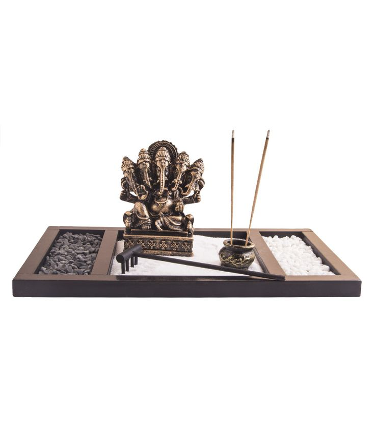 Panchmukhi Ganesha statue made in Polyresin. Placed on a rectangular wooden tray with sand, rocks, agarbati holder & rake, to create a mini serne oasis in your room.